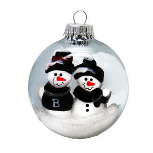 Silver glass ball ornament with two snowmen side by side. One has a B on its sweater.