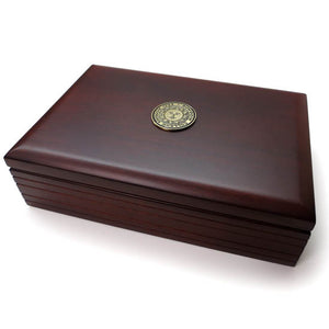 Dark mahogany finish rectangular wooden box with cast Bowdoin sun seal medallion on cover.