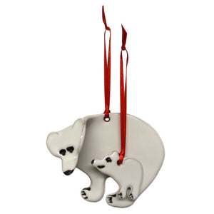 Two ceramic polar bear ornaments: one large and one small. Both have red ribbon hangers.