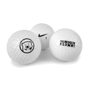 3 golf balls. One with mascot medallion, one with Nike swoosh, one with BOWDOIN ALUMNI imprint.