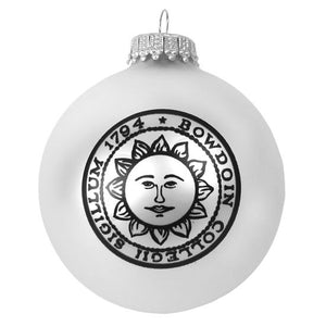 Matte silver glass ball ornament with black Bowdoin sun seal imprint.
