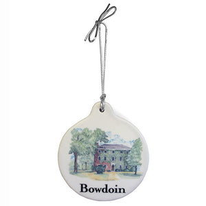 Natural color ceramic ornament with silver elastic hanger. Full-color watercolor-style image of Mass Hall on front, over the Bowdoin wordmark in black.