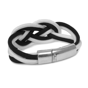 Back of Bracelet made of black and white cord, tied in a double carrick knot, showing closed metal clasp.