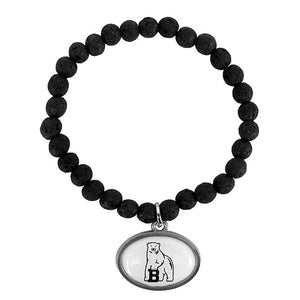 Bracelet made with black lava beads and silver finish pendant with inset of Bowdoin polar bear mascot in black on a white background.