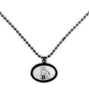 Oval pendant on matching ball chain. Pendant and chain have black gunmetal finish, pendant shows polar bear mascot on white background.