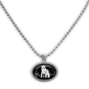 Oval pendant on matching ball chain. Pendant and chain have stainless steel finish, pendant shows polar bear mascot on black background.