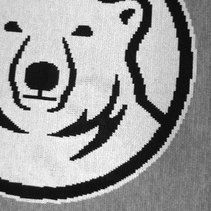 Close up detail showing the quality of the knitting in the mascot medallion.