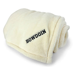 Cream white plush throw with black BOWDOIN embroidered in one corner.
