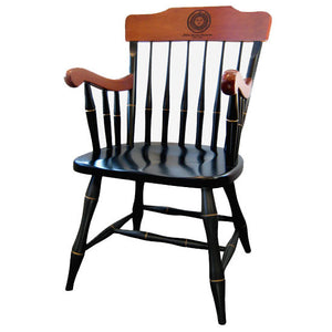 Painted black captain's chair with painted gold details and stained maple arms and backrest. Engraved with Bowdoin seal on backrest.