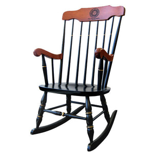 Black rocking chair with gold details and stained maple arms and top.