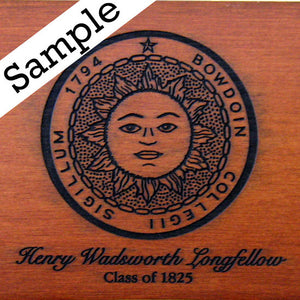 Closeup showing sample engraving on chair top of Bowdoin sun seal above cursive text HENRY WADSWORTH LONGFELLOW and below, in regular serif text CLASS OF 1825