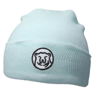 Baby blue knit baby hat with embroidered mascot medallion patch on turned-up cuff.