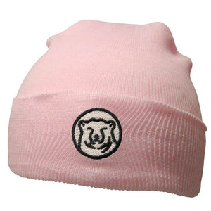 Baby pink knit baby hat with embroidered mascot medallion patch on turned-up cuff.