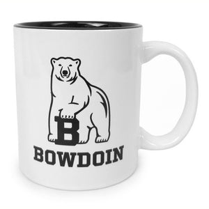 White coffee mug with black interior and polar bear mascot over BOWDOIN imprint.
