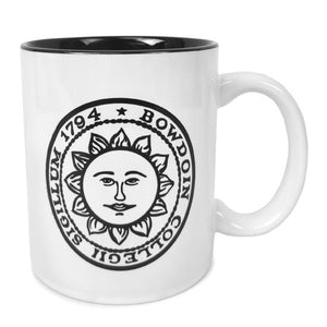 White coffee mug with black interior and Bowdoin sun seal imprint.