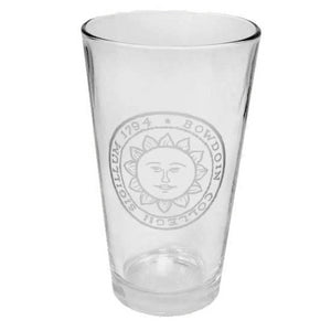 Clear pint mixing glass with engraved Bowdoin sun seal.