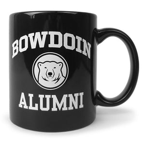 Black coffee mug with white imprint of BOWDOIN arched over a polar bear medallion over the word ALUMNI.