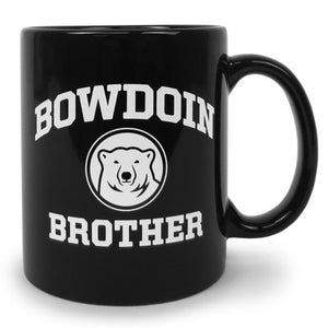 Black coffee mug with white imprint of BOWDOIN arched over a polar bear medallion over the word BROTHER.