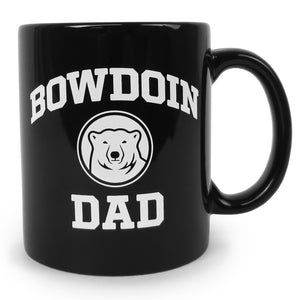 Black coffee mug with white imprint of BOWDOIN arched over a polar bear medallion over the word DAD.