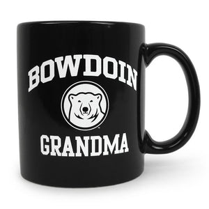 Black coffee mug with white imprint of BOWDOIN arched over a polar bear medallion over the word GRANDMA.