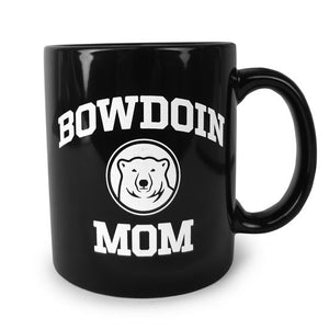 Black coffee mug with white imprint of BOWDOIN arched over a polar bear medallion over the word MOM.
