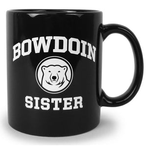 Black coffee mug with white imprint of BOWDOIN arched over a polar bear medallion over the word SISTER.