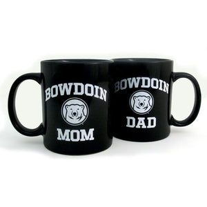 Two black coffee mugs side by side, one with BOWDOIN MOM imprint, the other with BOWDOIN DAD.