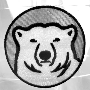 Closeup of embroidered Bowdoin polar bear medallion patch.
