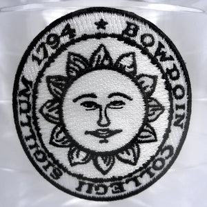 Closeup of ice bucket Bowdoin sun seal embroidered patch.