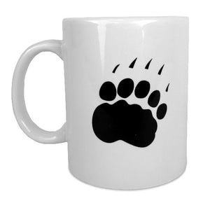 White coffee mug showing reverse side with black paw print.