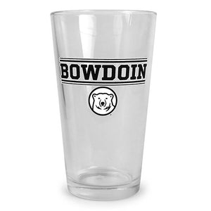 Clear pint glass with screen imprint of BOWDOIN in black with a white outline, sandwiched between pairs of thick and thin black bars with white outlines. Below is a two-color imprint of the polar bear medallion.