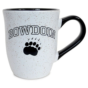 White mug shaped like an upside-down bell, in white with tiny tan speckles. Black outlined arched BOWDOIN over solid black paw imprint. Black glossy interior and handle.