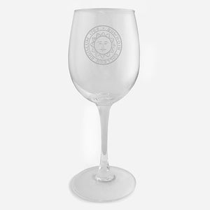Classic-shaped stemmed wine glass with etched Bowdoin College sun seal.