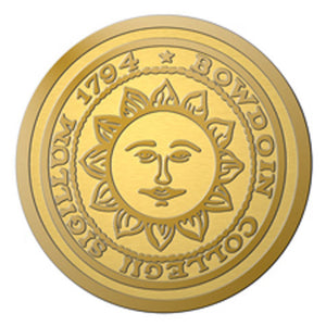 Closeup of engraved Bowdoin sun seal medallion.