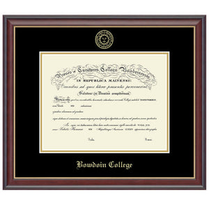 Mahogany-finish diploma frame with gold fillet and black and gold matting. Gold embossed Bowdoin College seal at the top of the mat, gold BOWDOIN COLLEGE in Old English text at the bottom.