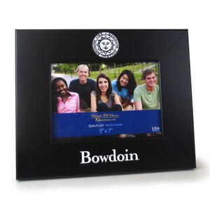 Black picture frame in horizontal layout with Bowdoin seal imprint on top of frame, and BOWDOIN on the bottom of the frame.