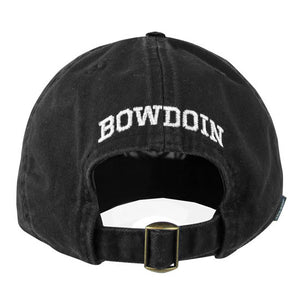 The back view of a black baseball cap showing the brass adjustable buckle closure and the word BOWDOIN embroidered in white over the opening.