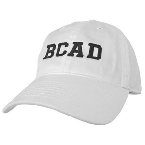 White ball cap with black embroidered BCAD on front.