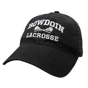 Black twill baseball cap with white embroidery of BOWDOIN arched over crossed lacrosse sticks over the word LACROSSE.