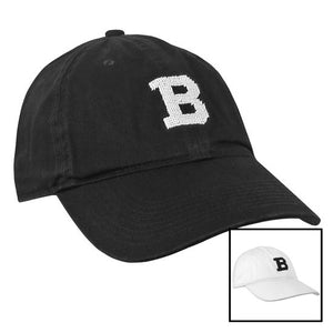 Montage of black and white S&B baseball hats.