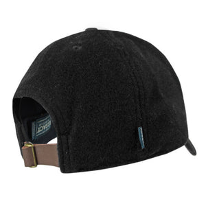 Back view of black wool ball cap showing brown leather adjustable closure with brass buckle.