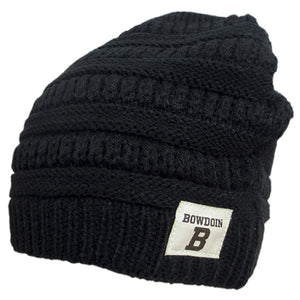 Slouchy knit beanie with alternating bands of chunky knitting. Rectangular patch on lower brim with BOWDOIN over the letter B imprinted in black on natural fabric.