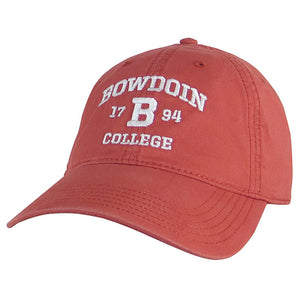 Nantucket red baseball hat with white embroidery of arched BOWDOIN over 17 B 94 over COLLEGE.