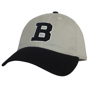 Ball cap in stone tan with black bill and button. Embroidered B decoration in black with white outline.