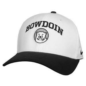White ball cap with black bill and button. Black arched BOWDOIN embroidered over polar bear medallion on front.
