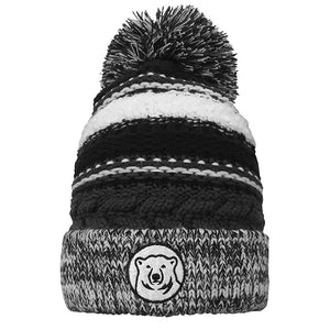 Knit hat in irregular stripes of grey, black, and white with marled cuff and oversized black, grey, and white pom. Embroidered mascot medallion patch on cuff.