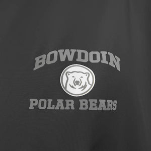 Closeup of imprint on black jacket, silver BOWDOIN arched over silver and white mascot medallion over silver POLAR BEARS.