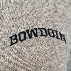Closeup of black arched BOWDOIN embroidery on oatmeal fleece.