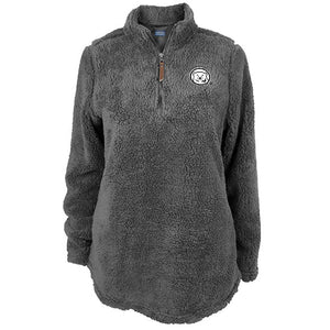 Plush grey pullover tunic with leather zipper pull and embroidered mascot medallion on left chest.