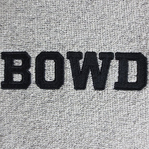 Closeup shot of the letters BOWD embroidered in black on grey terry fabric.